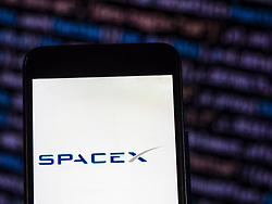 November 21, 2018 - Kiev, Ukraine - SpaceX Aerospace company logo seen displayed on smart phone. Space Exploration Technologies Corp., doing business as SpaceX, is a private American aerospace manufacturer and space transportation services company (Credit Image: © Igor Golovniov/SOPA Images via ZUMA Wire)