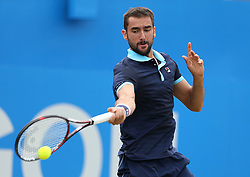 Croatia's Marin Cilic in action against USA's Donald Young during day five of the 2017 AEGON Championships at The Queen's Club, London. PRESS ASSOCIATION Photo. Picture date: Friday June 23, 2017. See PA story TENNIS Queens. Photo credit should read: Steven Paston/PA Wire. RESTRICTIONS: Editorial use only, no commercial use without prior permission.