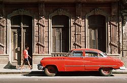 Red car parked on Havana street  San Lazaro; Centro district,