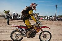 209x Sportsman class motorcycle ridden by Derek Duncan arrives at finish of 2011 San Felipe Baja 250
