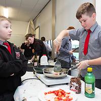 Ronan Kilroy makes pancakes for the Ennis National School  Jessies Showcase Day