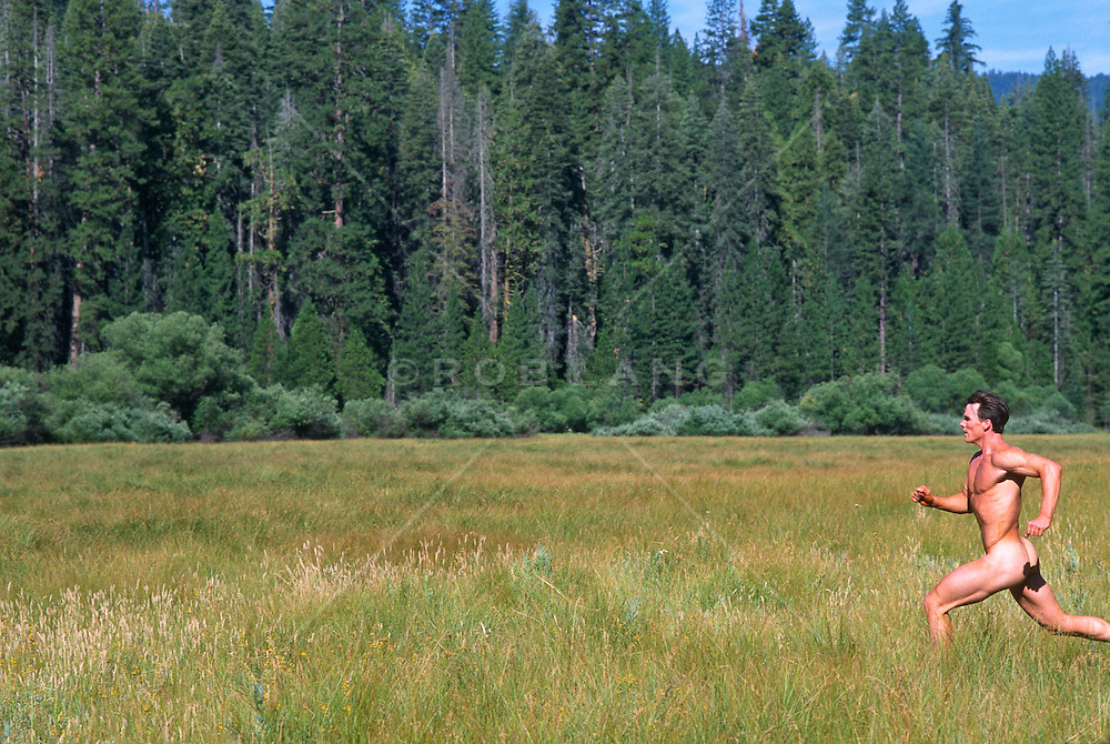 Nude man running through a Yosemite Park meadow