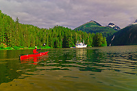 Passenger of the Ursa Major charter ship sea kayaking in Red Bluff Bay, Inside Passage, Southeast Alaska