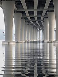 United States, Washington, Seattle, Lake Washington and underside of 520 floating bridge