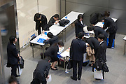 young Japanese people filling out paperwork at a job hunting event Tokyo Japan