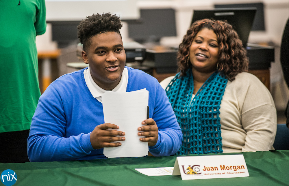A.L. Brown football player Juan Morgan signs his letter of intent to play at University of Charleston in West Virginia. Fellow Kannapolis players Jalyn Cagle, Sandon McCoy and Dantrell Barkley signed letters of intent to play football at the Western Carolina University, Gardner-Webb University and Independence Community College, respectively, Wednesday afternoon at A.L. Brown.