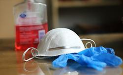 Coronavirus prevention medical surgical masks, gloves and hand sanitiser gel for hand hygiene coronavirus protection. Picture date: Thursday April 2, 2020.