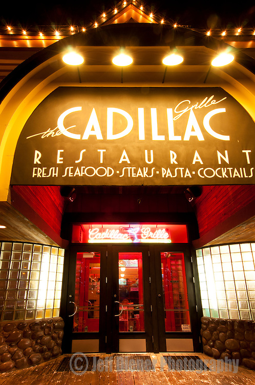 The Cadillac Grill restaurant glows with life at night in downtown Jackson Hole, Wyoming.