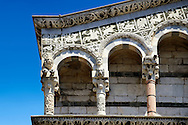 Close up of the Arcades and corner of St Michele of the 13th century Romanesque facade of the San Michele in Foro,  a Roman Catholic basilica church in Lucca, Tunscany, Italy . .<br /> <br /> Visit our ITALY PHOTO COLLECTION for more   photos of Italy to download or buy as prints https://funkystock.photoshelter.com/gallery-collection/2b-Pictures-Images-of-Italy-Photos-of-Italian-Historic-Landmark-Sites/C0000qxA2zGFjd_k<br /> <br /> If you prefer to buy from our ALAMY PHOTO LIBRARY  Collection visit : https://www.alamy.com/portfolio/paul-williams-funkystock/lucca.html .<br /> <br /> Visit our MEDIEVAL PHOTO COLLECTIONS for more   photos  to download or buy as prints https://funkystock.photoshelter.com/gallery-collection/Medieval-Middle-Ages-Historic-Places-Arcaeological-Sites-Pictures-Images-of/C0000B5ZA54_WD0s