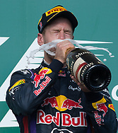 Formula 1 World Champion Sebastian Vettel celebrates winning the 2013 United States Grand Prix at the Circuit of the America's in Austin, Texas.