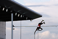 Super 8 athletics at the Cardiff International Stadium on Wed 10th June 2009. a competitor competes in the men's polevault event.