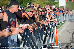 Crowd enjoying Chris Theis' Street Cowboys stunt show at Hal's Harley-Davidson during the Milwaukee Rally. Milwaukee, WI, USA. Friday, September 2, 2016. Photography ©2016 Michael Lichter.
