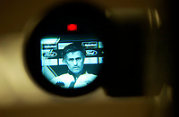 Photo: Daniel Hambury.<br />Chelsea Press Conference and Training.<br />12/09/2005.<br />Chelsea's Jose Mourinho is seen throught the lens of a TV camera at the news conference.