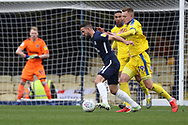 Southend United midfielder Stephen McLaughlin (11) battles for possession with AFC Wimbledon striker Joe Pigott (39) during the EFL Sky Bet League 1 match between Southend United and AFC Wimbledon at Roots Hall, Southend, England on 16 March 2019.