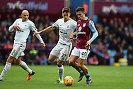 Jack Grealish of Aston Villa ® looks to go past Swansea's Federico Fernandez.  Barclays Premier league match, Aston Villa v Swansea city at Villa Park in Birmingham, the Midlands on Saturday 24th October 2015.<br /> pic by  Andrew Orchard, Andrew Orchard sports photography.
