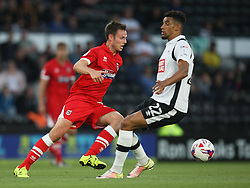 James Berrett of Grimsby Town (L) and Nick Blackman of Derby County in action - Mandatory by-line: Jack Phillips/JMP - 09/08/2016 - FOOTBALL - iPro Stadium - Derby, England - Derby County v Grimsby Town - EFL Cup First Round