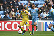 Bristol Rovers midfielder Ed Upson (6) sprints forward with the ball under pressure from Coventry City midfielder Liam Kelly (6) during the EFL Sky Bet League 1 match between Coventry City and Bristol Rovers at the Ricoh Arena, Coventry, England on 7 April 2019.