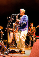 Colombian band Ondatropica live at the Hackney Empire, London E8, UK, on Colombian Independence Day (20 July 2012). Legendary sax player Michi Sarmiento. © Rudolf Abraham