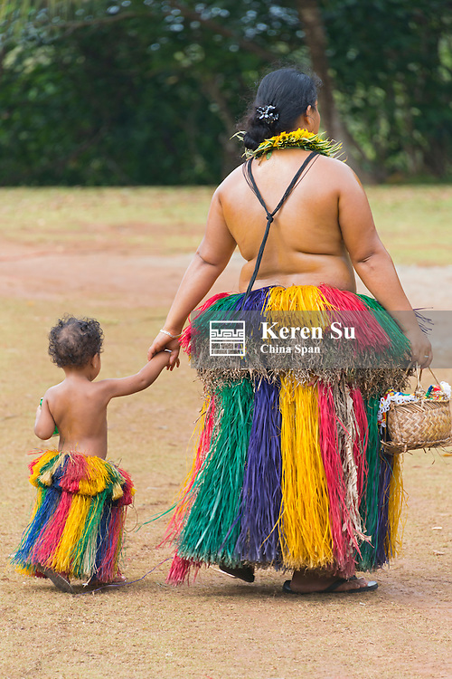 Yapese woman wiith little girl in traditional clothing at Yap Day Festival, Yap Island, Federated States of Micronesia