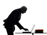 One Caucasian Senior Business Man computing laptop typing Silhouette White Background
