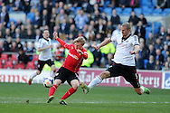Cardiff city's Mats Daehli (l) has a shot at goal blocked by Fulham's Brede Hangeland.  Barclays Premier league, Cardiff city v Fulham at the Cardiff city Stadium in Cardiff , South Wales on Sat 8th March 2014. pic by Andrew Orchard, Andrew Orchard sports photography