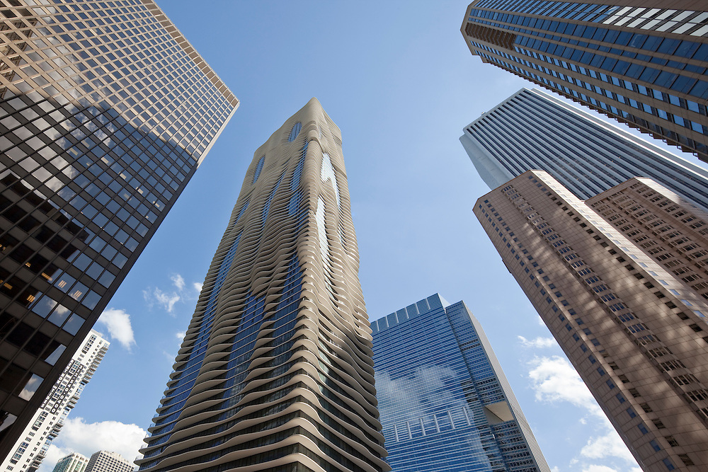 Chicago's Aqua Tower in the Lakeshore East neighborhood of downtown Chicago, flanked by a series of Chicago skyscrapers including the Aon Building, the Fairmont Hotel, and Three Illinois Center in photograph by best Chicago Architectural Photographer Wayne Cable, Chicago Photographer, producer of Chicago Photography