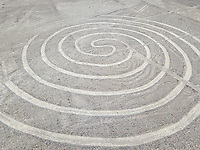 Aerial view of circular geometric shapes geoglyph in Nazca, Peru.