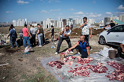 People butcher cattle which were sacrificed during Eid-al-Adha celebrations in Istanbul, Turkey on August 21, 2018. Muslims across the world are celebrating the annual festival of Eid al-Adha or the festival of sacrifice which marks the end of the Hajj pilgrimage to Mecca and commemorates prophet Abraham's readiness to sacrifice his son to show obedience to God.Photo by Depo Photos/ABACAPRESS.COM