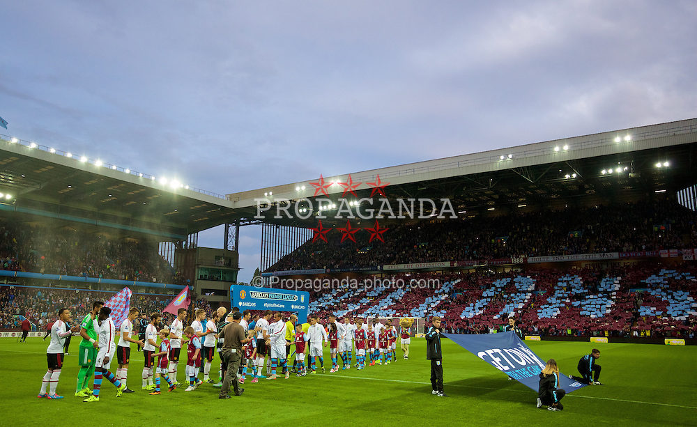 BIRMINGHAM, ENGLAND - Friday, August 14, 2015: Aston Villa and Manchester United players shake hands before the Premier League match at Villa Park. (Pic by David Rawcliffe/Propaganda)