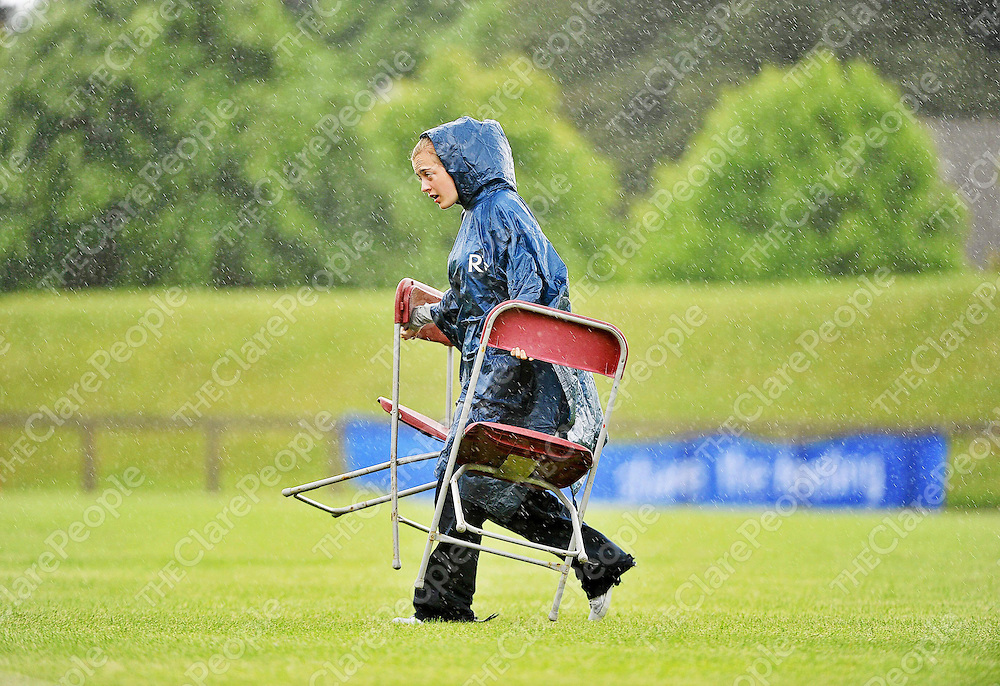 13 June 2010; Voulenteer Croidh Fitzgerald, from Newmarket, Clare, goes for cover during a downpour during the final day of the 2010 Special Olympics Ireland Games. University of Limerick, Limerick. Picture credit: Stephen McCarthy / SPORTSFILE *** NO REPRODUCTION FEE ***