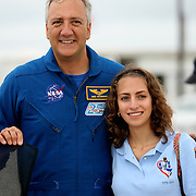 """Astronaut Mike Massimino (L) and his daughter Gabby visit the launch pad at the Kennedy Space Center Thursday, July 7, 2011, in Cape Canaveral, Fla. Massimino was the first astronaut to use """"Twitter"""" to tweet from space. (AP Photo/Alex Menendez)"""