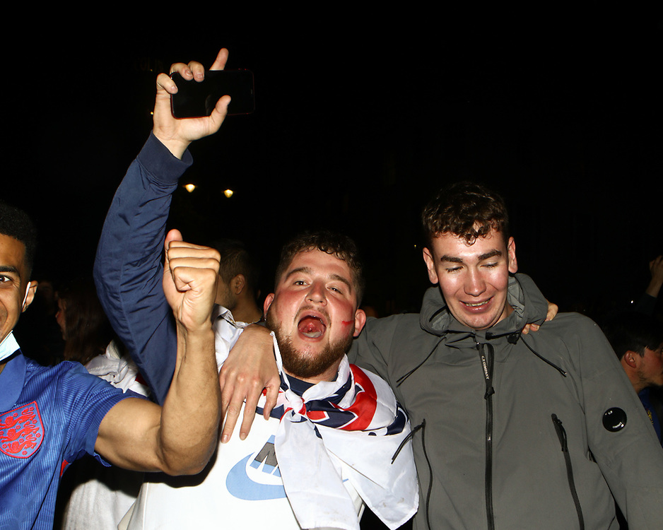 Supporters at Trafalgar Square celebrating England scoring the final penalties of the game at the Euro 2020 finals. 11/07/2021, Marcin Riehs/Pathos