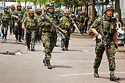 May 19 - BANGKOK, THAILAND: Thai reinforcements enter Lumpini Park during the Thai government crack down against Red Shirt and anti government protesters. The Royal Thai Army attacked anti-government protesters May 19 with troops and armored personnel carriers. Photo by Jack Kurtz