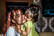 Martina Ferkova with her daughter in their flat at the Stará Tehelňa housing complex - a segregated district populated with mostly Roma, located in the city of Presov in Eastern Slovakia.
