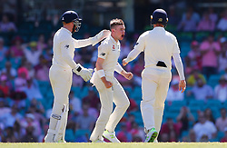 England's Mason Crane celebrates the wicket of Australia's Usman Khawaja during day two of the Ashes Test match at Sydney Cricket Ground.