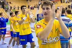 David Razgor of Celje  celebrates after the handball match between RK Celje Pivovarna Lasko and IK Savehof (SWE) in 3rd Round of Group B of EHF Champions League 2012/13 on October 13, 2012 in Arena Zlatorog, Celje, Slovenia. (Photo By Vid Ponikvar / Sportida)
