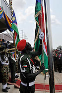 An SPLA soldier raises the new flag of the Republic of South Sudan for the first time at the official independence day ceremony. After decades of conflict, Southern Sudan declared independence from the North on July 9th, 2011. Government officials, foreign dignitaries and ordinary people came to the John Garang Memorial in the capital from all over the country and the world to celebrate the historic occation..Juba, South Sudan. 09/07/2011..Photo © J.B. Russell