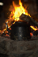 Coffee Warming By a Wood Fire after the Dog Sled Trip Tromsø. Image taken with a Nikon D2xs and 85 mm f/1.4 lens (ISO 200, 85 mm, f/1.4, 1/60 sec)..