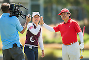 Lydia Ko and Dr. Haruhisa Handa, Chairman of the International Sports Promotion Society (ISPS HANDA), during the Pro-Am Golf Tournament run before the ISPS Handa NZ Women's Open held at Clearwater Golf Course. 11 February 2016. Photo: Joseph Johnson / www.photosport.nz