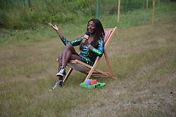 Latitude Festival 2017, Henham Park, Suffolk, UK. TV presenter AJ Odudu doing a piece to camera for E4