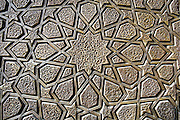 A decorative pattern carved onto the doors of the Jameh Mosque in Yazd, Iran.