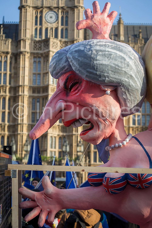 As Prime Minister Theresa May tours European capitals hoping to persuade foreign leaders to accept a new Brexit deal following her cancellation of a Parliamentary vote, pro-EU Remainers protest with satirical figure of Theresa May opposite the Houses of Parliament, on 11th December 2018, in London, England.