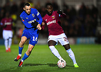 Football - 2018 / 2019 Emirates FA Cup - Fourth Round: AFC Wimbledon vs. West Ham United<br /> <br /> West Ham United's Arthur Masuaku holds off the challenge from AFC Wimbledon's Dylan Connolly, at Cherry Red Records Stadium (Kingsmeadow).<br /> <br /> COLORSPORT/ASHLEY WESTERN