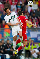 Zlatan Ljubijankic of Slovenia vs Gareth Barry of England during the 2010 FIFA World Cup South Africa Group C Third Round match between Slovenia and England on June 23, 2010 at Nelson Mandela Bay Stadium, Port Elizabeth, South Africa.  (Photo by Vid Ponikvar / Sportida)