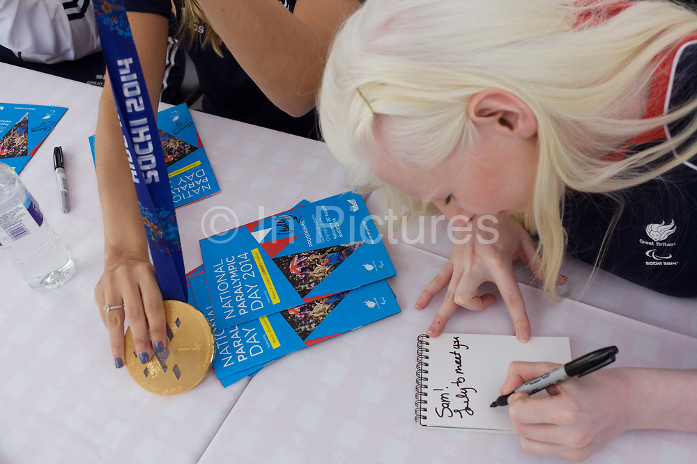 Partially-sighted skiing paralympian from the Sochi Olympics, Kelly Gallagher signs autographs at the National Paralympic Day, Stratford, London. Gallagher was one of seven skiers for Great Britain at the 2010 Winter Paralympics and became the first athlete from Northern Ireland to compete in the Winter Paralympics. Kelly Marie Gallagher, MBE is a Northern Irish skier and the first athlete from Northern Ireland to compete in the Winter Paralympics. Gallagher won Britain's first ever Winter Paralympic gold medal during Sochi 2014.