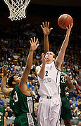 BYU forward Josh Sharp (12) makes a layup during the second half of the NCAA basketball game between the BYU Cougars and the Eastern New Mexico Greyhounds at the Marriott Center, Tuesday, Dec. 18, 2012.