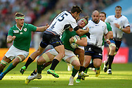 Jamie Heaslip, the Ireland captain is hit hard in a tackle by Catalin Fercu of Romania. Rugby World Cup 2015 pool D match, Ireland v Romania at Wembley Stadium in London on Sunday 27th September 2015.<br /> pic by John Patrick Fletcher, Andrew Orchard sports photography.