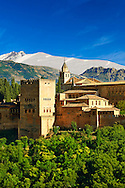 """View of the Moorish Islmaic Alhambra Palace comples and fortifications. Granada, Andalusia, Spain. . The Alhambra is a palace and fortress complex located in Granada, Andalusia, Spain. It was originally constructed as a small fortress in 889 CE on the remains of ancient Roman fortifications. The Alhambra was renovated and rebuilt in the mid-13th century by the Arab Nasrid emir Mohammed ben Al-Ahmar of the Emirate of Granada, who built its current Alhambra palace and walls. The Alhambra was converted into a royal palace in 1333 by Yusuf I, Sultan of Granada. The decoration of The Alhambra consists for the upper part of the walls, as a rule, of Arabic inscriptions—mostly poems by Ibn Zamrak and others praising the palace—that are manipulated into geometrical patterns with vegetal background set onto an arabesque setting (""""Ataurique""""). Much of this ornament is carved stucco (plaster) rather than stone. Tile mosaics (""""alicatado"""") of The Alhambra, with complicated mathematical patterns (""""tracería"""", most precisely """"lacería""""), are largely used as panelling for the lower part. .<br /> <br /> Visit our SPAIN HISTORIC PLACXES PHOTO COLLECTIONS for more photos to download or buy as wall art prints https://funkystock.photoshelter.com/gallery-collection/Pictures-Images-of-Spain-Spanish-Historical-Archaeology-Sites-Museum-Antiquities/C0000EUVhLC3Nbgw <br /> .<br /> Visit our ISLAMIC HISTORICAL PLACES PHOTO COLLECTIONS for more photos to download or buy as wall art prints https://funkystock.photoshelter.com/gallery-collection/Islam-Islamic-Historic-Places-Architecture-Pictures-Images-of/C0000n7SGOHt9XWI"""