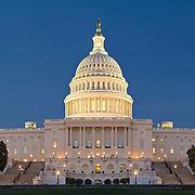 US Capitol building at dusk. Senate side is left of frame; House of Representatives is at right. Presidential inaugurals traditionally take place on a temporary platform directly in front of the central dome.
