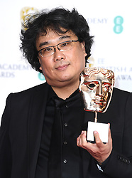 Bong Joon-ho in the press room after winning the award for Best Film Not In The English Language and Best Original Screenplay at the 73rd British Academy Film Awards held at the Royal Albert Hall, London.. Photo credit should read: Doug Peters/EMPICS